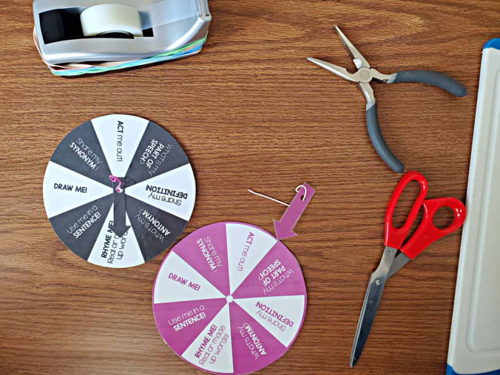 black and purple word wheels with pliers, scissors and tape