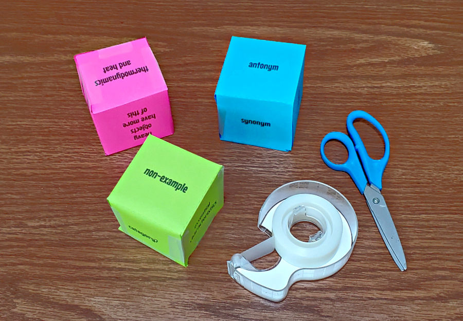 assembled concept cubes in blue, pink, and green